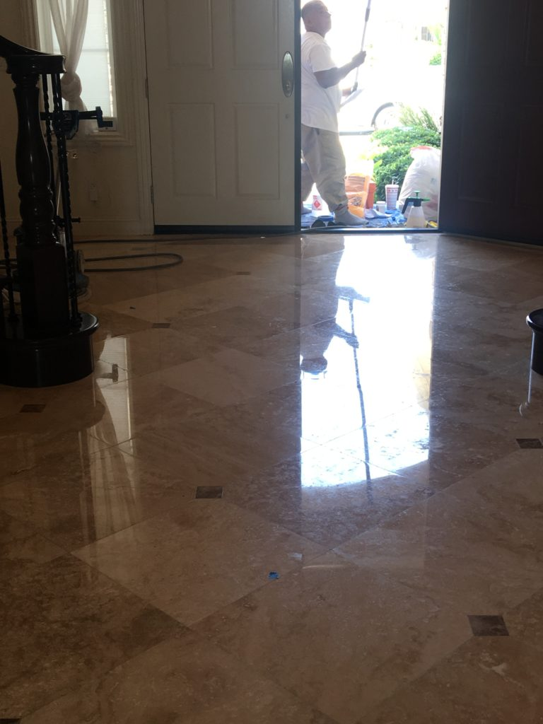 Polished and sealed travertine